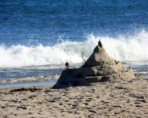 I watched as the tide came in and the waves licked away this sand castle.